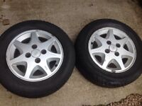 "14"" Ford 7 spoke alloy wheels."