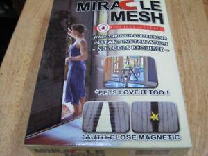 miracle mesh walk through screen door. 100% brand new.