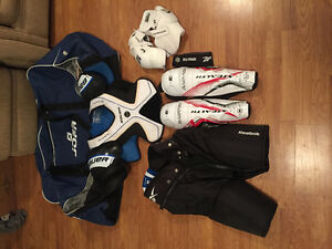Hockey equipment with bag, good condition.