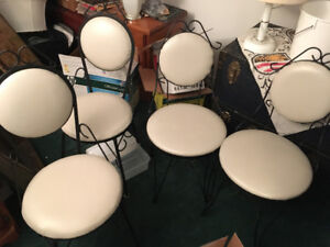 Rod Iron Chairs with white leather top!