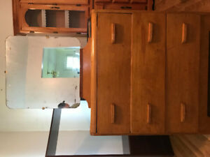 Real wood old dresser with mirror .