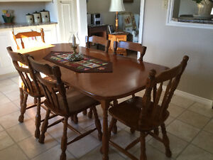 Solid Maple table and 6 chairs.