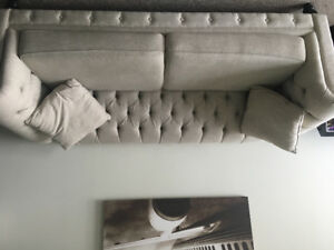 Cream coloured tufted couch