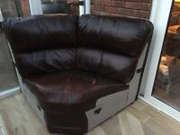 Corner section leather settee