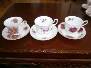 THREE SWEET ROYAL ALBERT CUP AND SAUCER SETS