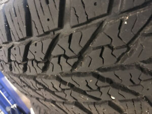 225/60/17  Goodyear Ultra Grip Snowtire 90% left with Rim