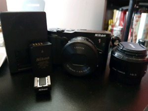 Nikon 1 V3 with kit lens and 18.5mm prime and more