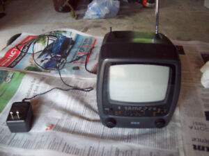 5 inch Black and White TV with AM/FM and weather stations.
