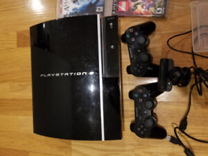 Playstation 3 with 2 controllers, webcam and games.