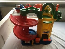 Fisher price garage and four cars