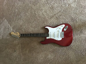 RED AND WHITE FENDER STRAT GUITAR