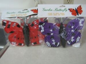 TWO DECORATIVE PLASTIC BUTTERFLIES - NEW IN THE PACKAGES