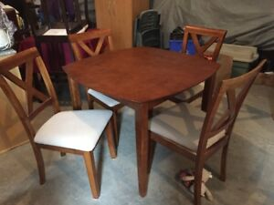 Wood table with 4 padded chairs