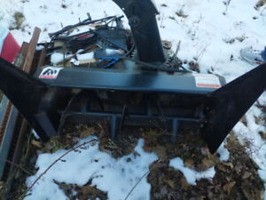Ride on lawn mower with snow blower attachment