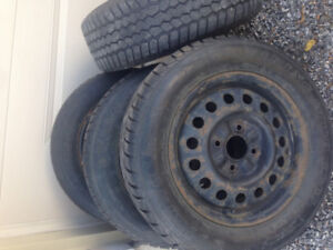 4/ HONDA CIVIC WINTER TIRES, 2 TIRES ARE GOOD, 2 NOT
