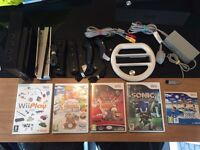 Wii black with 5 games