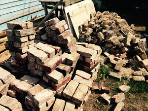 Large amount of reclaimed used bricks clay red solid type