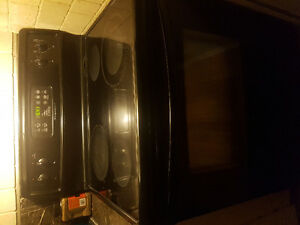 Black Frigidaire Fridge & Smooth Top Stove