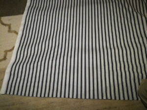 Blue and white striped fabric roll