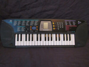 Casio SA-65 SongBank -100-Tone Keyboard & AC Adapter