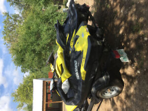 2 seadoo's with trailer and covers.