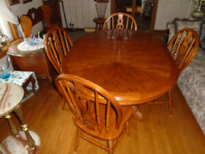 FurnitureOAK DINING TABLE AND FOUR CHAIRS - $280