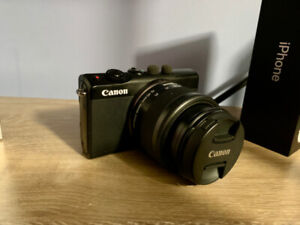 Canon M100 camera for sale with included EF lens adapter.