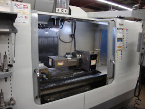 HAAS VF-3SS LOADED WITH TRT-160 5 AXIS ROTARY TABLE
