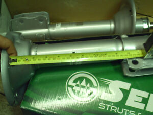 Subaru Legacy Outback etc rear struts shocks 99 under