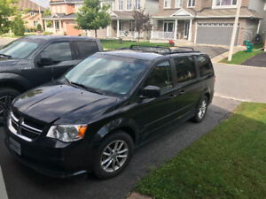 2013 Dodge Caravan, black with DVD player and low