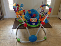 BABY JUMPER+10 TOYS, 75$ THE LOT