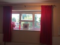 Red curtain with curtain pole