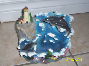 decorative fountain ,ocean with lighthouse and dolphins