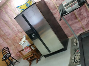 Side by Side fridge for sale or trade. Has ice and water.
