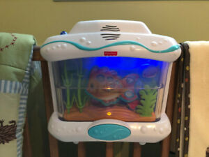 Fisher Price Aquarium with Swimming Fish, Music, & Happy Sounds.