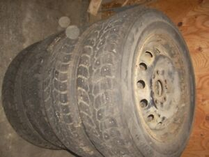 4 studded  tires 185/70/14 on rims come off of a toyota
