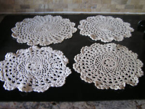 Four Off White Crocheted Cotton Doilies