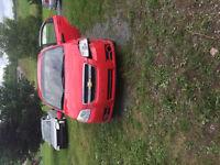2007 Chevrolet Aveo Sedan trade for a 4 wheeler