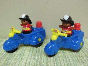 2 Motos bruit d'une sirène de pompier Little People...$8 CH.