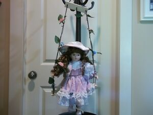 VINTAGE DOLL ON SWING