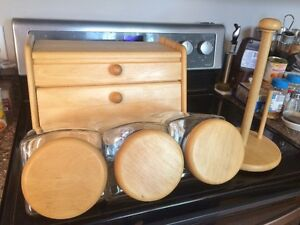 Matching bread box, paper towel holder and 3 piece canister set.