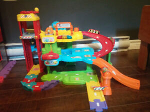 Car garage toy with lights and sounds - $20