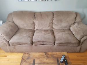 Brown couch and matching loveseat