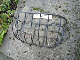 Metal wall or fence mounted planter basket