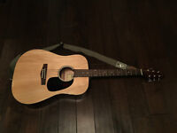 Acoustic guitar, strap, and carrying case.