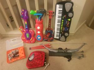 Kids guitars, keyboard,  golf set, musical drum sticks,tools ect