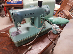 Vintage singer sewing machine and button holer attachment