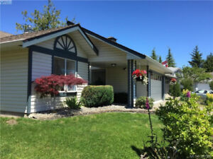 This elegant home is extensively updated with cherry