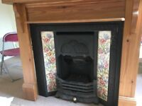 Victorian style cast iron fireplace with gas fire wood mantle surround