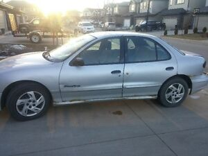 Sunfire with summer and winter tire set on rims